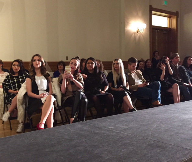Provo Fashion Week Paparazzi Posse Giveaway Winner sitting front row at the fashion show with Lovely Desert and Diana Putnam Photography