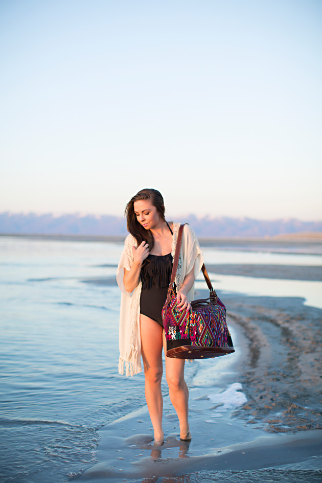 A black one piece swimsuit with fringe and a classy coverup. This modest one-piece and cover-up were styled by Lovely Deseret and Photographed by Diana Putam Photography