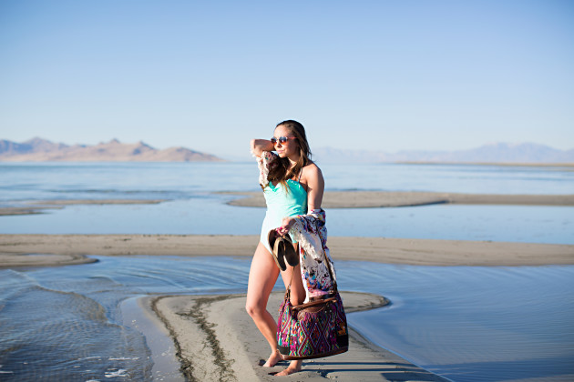 A mint one-piece swimsuit and guatemalan bag styled by modest fashion blogger Lovely Deseret photographed by Diana Putnam Photography