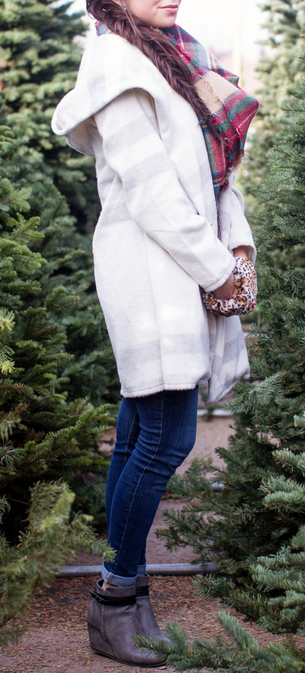 Plaid winter coat and blanket scarf winter fashion worn with with jeans and booties and a side fishtail braid in a christmas tree lot.