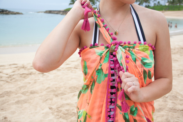 modest swimsuit coverup tied up as a pom pom beach coverup