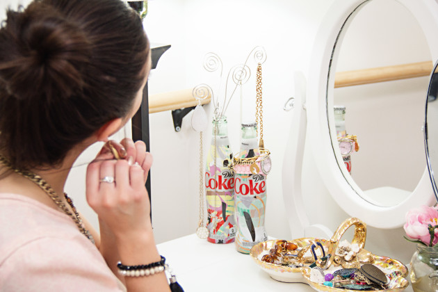 Fashion blogger Modest Goddess gives a tutorial of how to make a DIY jewelry display out of Diet Coke It's Mine bottles.