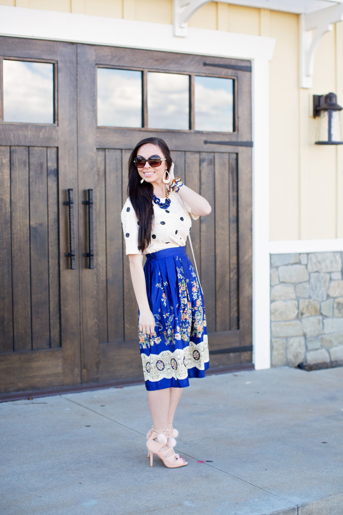 Modest fashion blogger Modest Goddess styles a modest navy skirt with cream accents, a modest sequin top, and pom pom lace-up heels as a modest spring outfit!