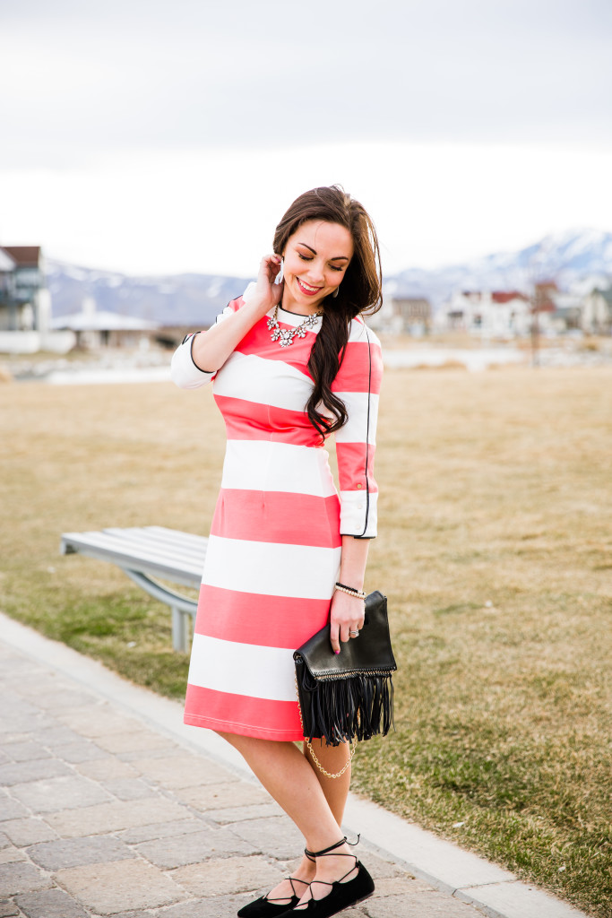 Modest fashion blogger Modest Goddess styles a modest coral and white striped dress, a modest striped Downeast dress, with black accessories and tassels in beautiful Daybreak in Utah.