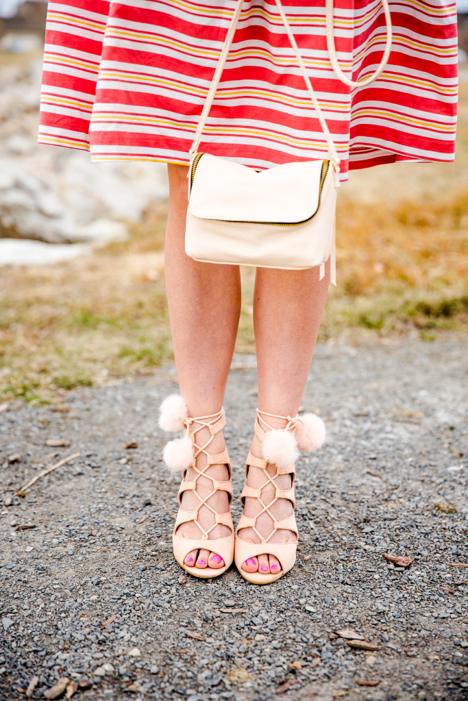 Nude lace up heels with pom poms