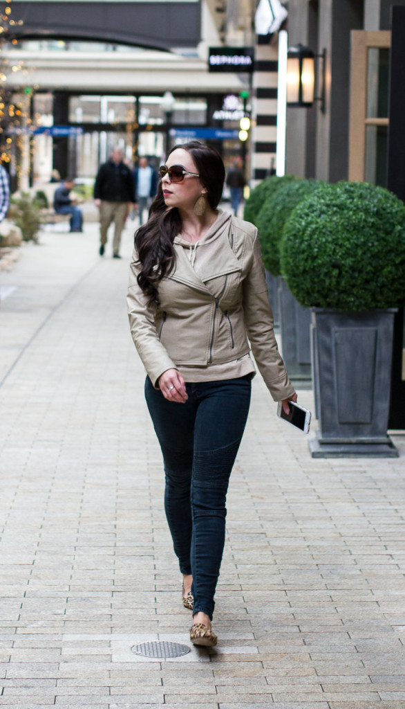 Modest Goddess styles a tan leather jacket with black moto jeans and leopard flats city style.