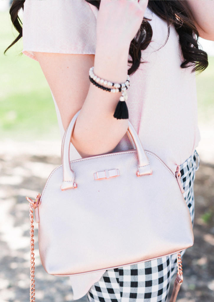 Modest Fashion Blogger Modest Goddess styles a blush top, gingham crops, and a rose gold bag for spring.