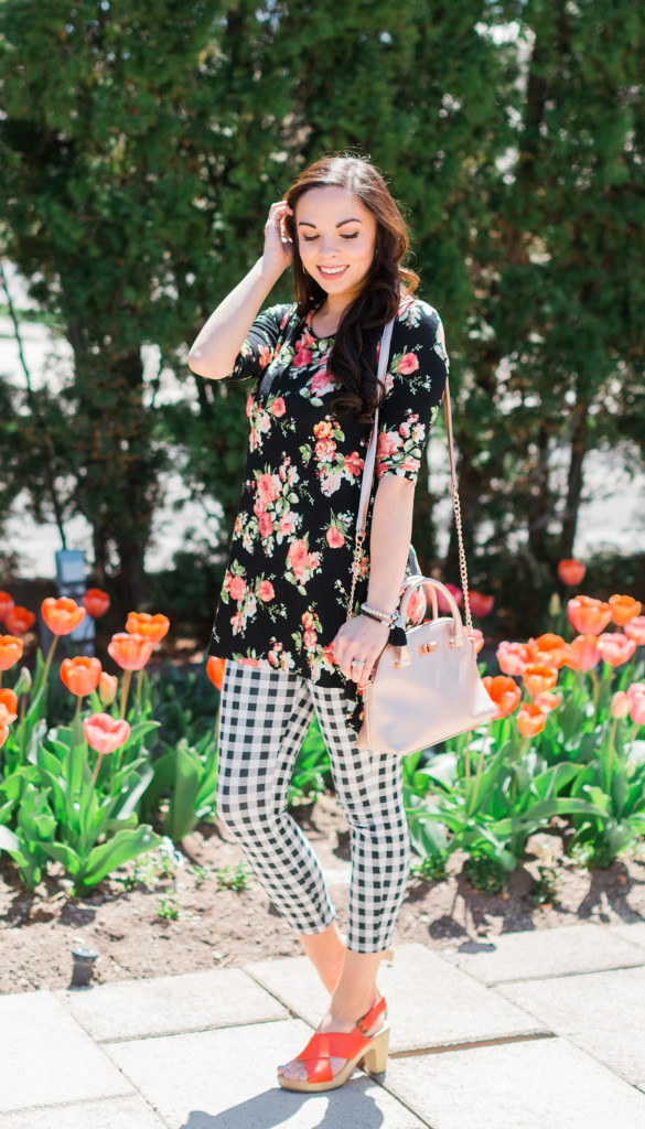 Modest fashion blogger Modest Goddess styles a black floral top with gingham crops for a cute modest spring outfit by the tulips.