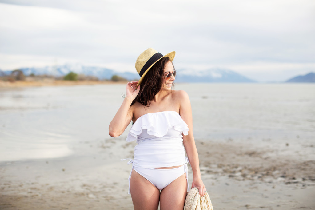 Modest Fashion Blogger Modest Goddess styles a modest white swimsuit from modest swimwear company Hush & Salt Swimwear.