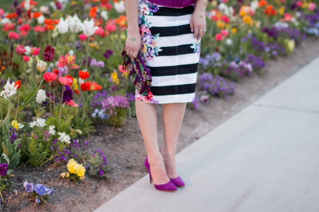 Modest fashion blogger Modest Goddess styles a modest purple blouse from modest boutique Great Lengths Shop with a striped floral skirt and purple suede Steve Madden heels.