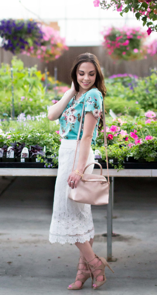 Modest fashion blogger Modest Goddess styles a modest floral top with a modest white lace pencil skirt with tan lace up sandals in a beautiful greenhouse.