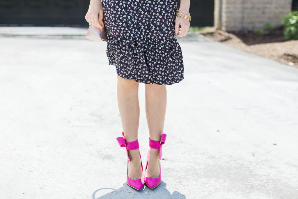 Modest Fashion Blogger Modest Goddess styles a modest bow dress with a cute black and white bow print with pink bow heels and a bow bag.