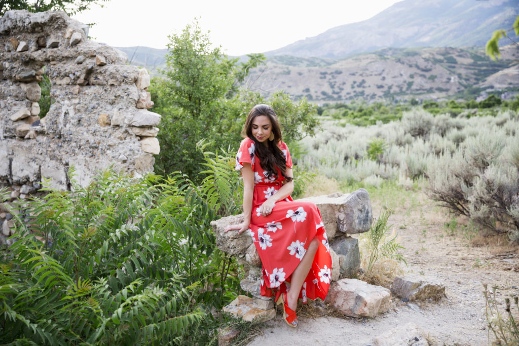 Modest fashion blogger Modest Goddess styles a floral coral modest high-low dress in this Alpine, UT photoshoot.