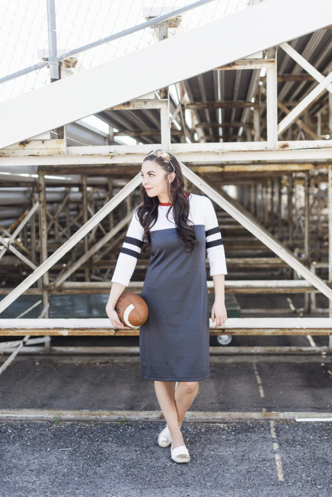 Modest Fashion Blogger Modest Goddess styles a sporty dress, the Kickoff Dress from Shabby Apple, to wear to football games.Modest Fashion Blogger Modest Goddess styles a sporty dress, the Kickoff Dress from Shabby Apple, to wear to football games.