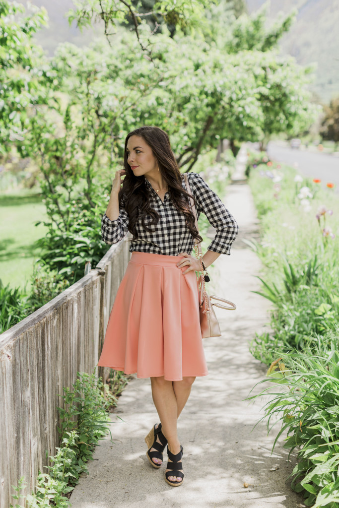 Modest fashion blogger Modest Goddess styles a modest peach midi skirt from Sexy Modest boutique with a black and white gingham top and black wedges for a cute modest summer skirt outfit.