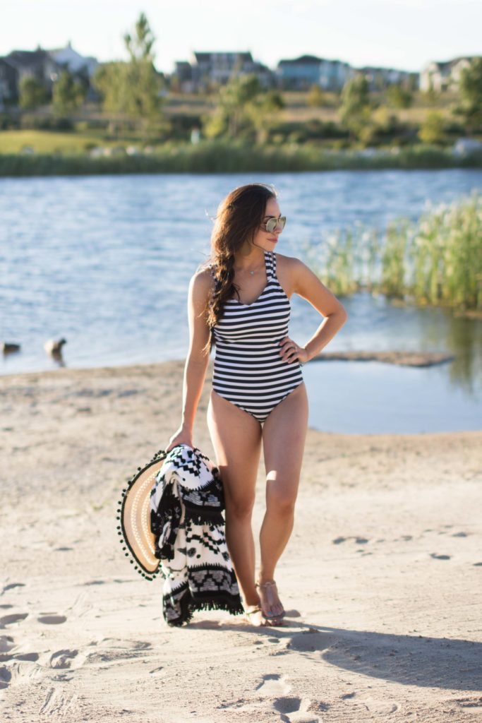 Modest fashion blogger Modest Goddess styles a modest striped one-piece swimsuit with a pretty back from Curl Gurl Swimwear.