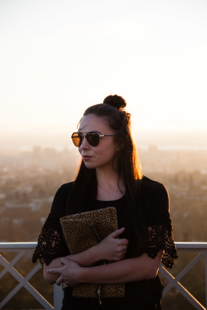 Modest fashion blogger Modest Goddess styles a black on black chic modest outfit with pops of leopard accents in the East Bay.