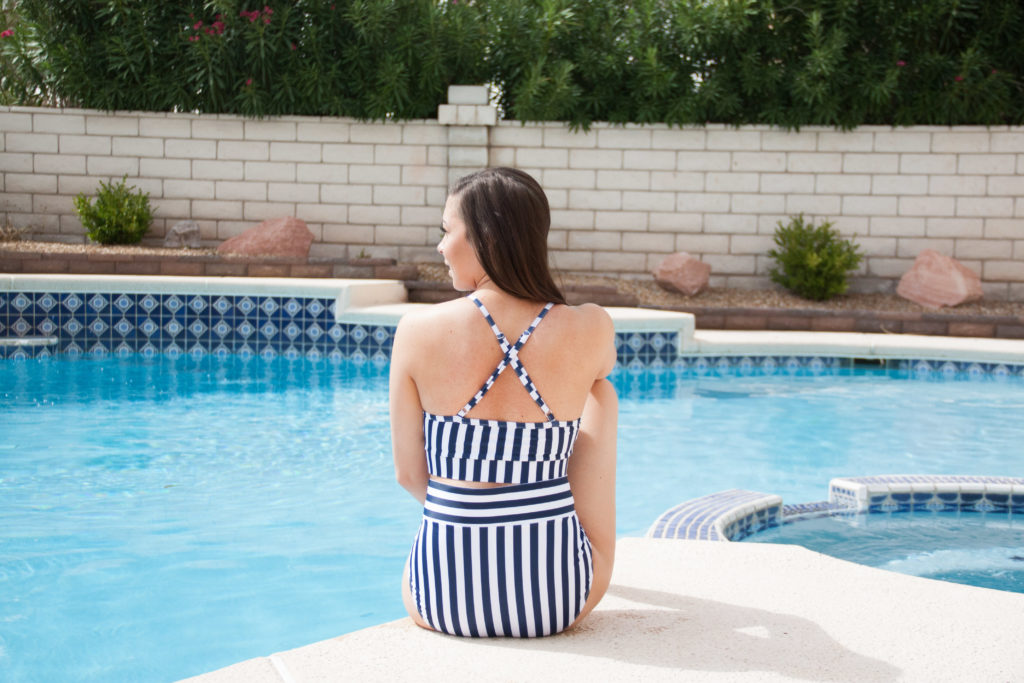 75c688cfa7b37 Modest fashion blogger Modest Goddess styles a navy modest swimsuit romper  and the swimsuit it comes ...