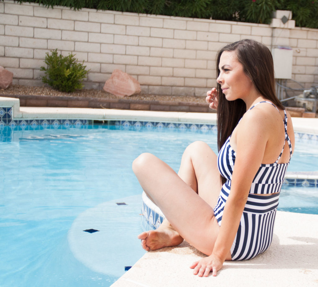 4693128a71d5c ... Modest fashion blogger Modest Goddess styles a navy modest swimsuit  romper and the swimsuit it comes ...