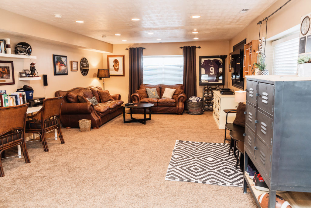 Industrial chic game-ready living room where you both can feel at home. This football coach and blogger wife totally nailed this style. #footballteamfriendly