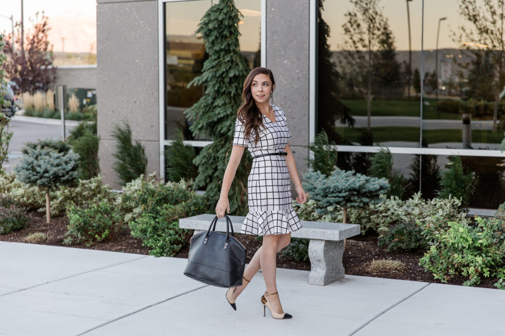 Modest fashion blogger Modest Goddess styles a modest white windowpane dress, a cute modest work outfit.