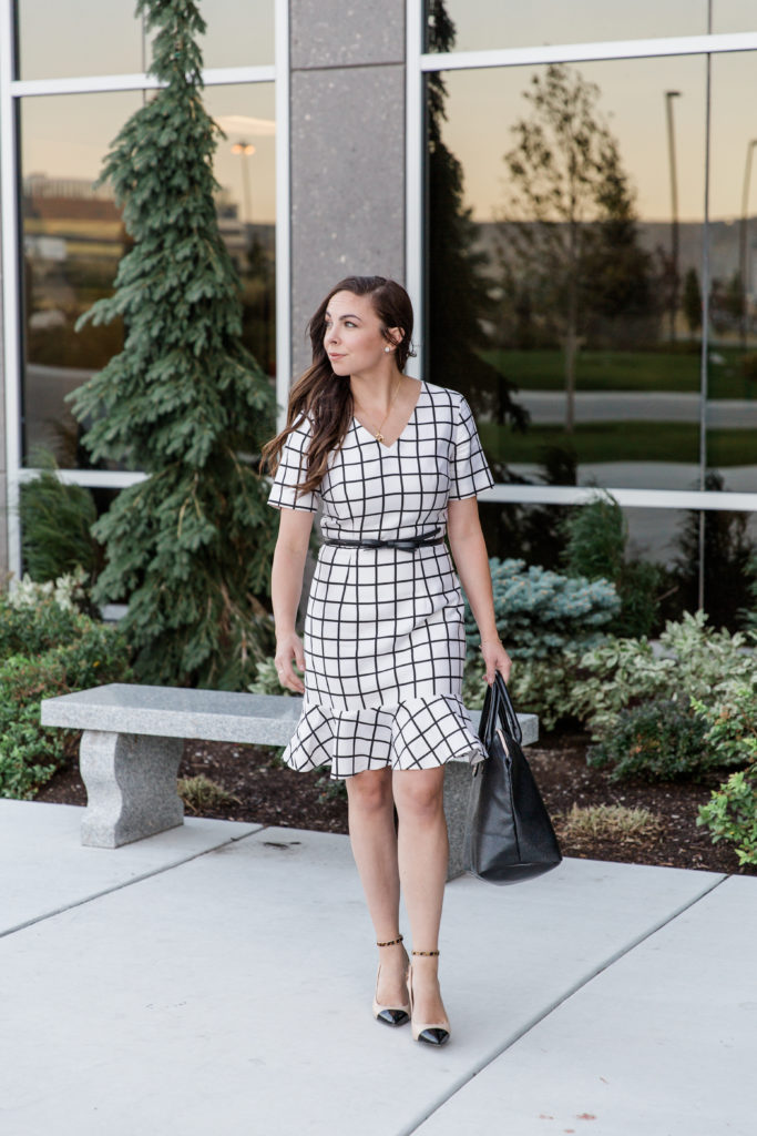 Modest fashion blogger Modest Goddess styles a modest white windowpane plaid dress, a modest business professional dress.