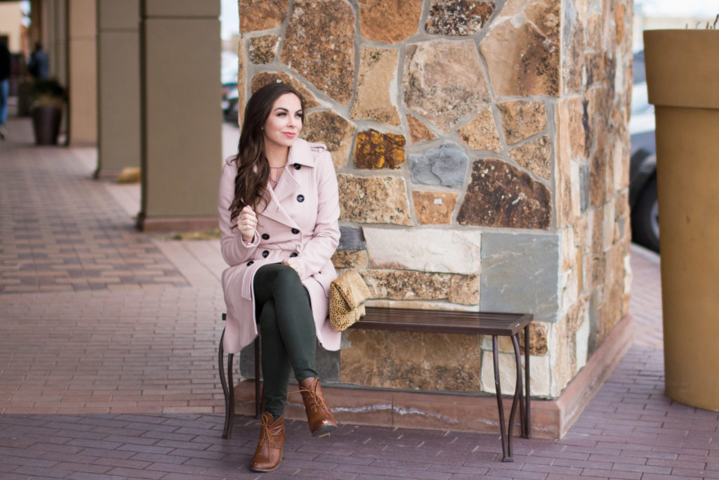 Modest fashion blogger Modest Goddess styles olive pants and and modest dusty pink lace-up top and dusty pink wool coat for winter style.
