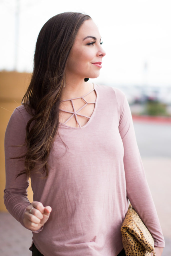 Modest fashion blogger Modest Goddess styles olive pants and and modest dusty pink lace-up top for winter style.