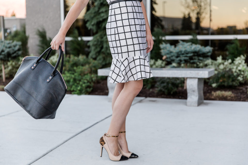 Modest fashion blogger Modest Goddess styles a modest white windowpane plaid dress, a modest business professional outfit.