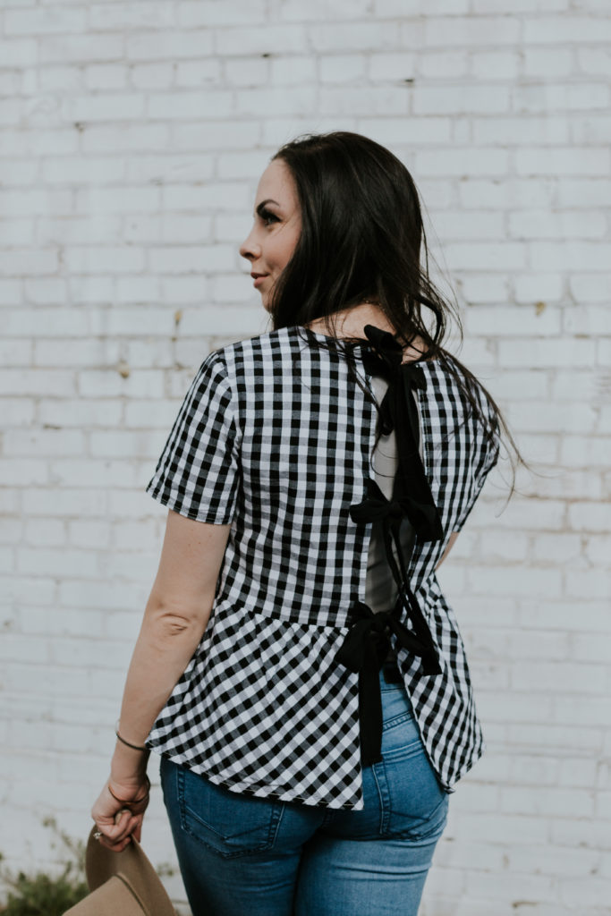 Modest fashion blogger styles a modesty hack of a lace-up gingham peplum top by layering it with a modesty tee.