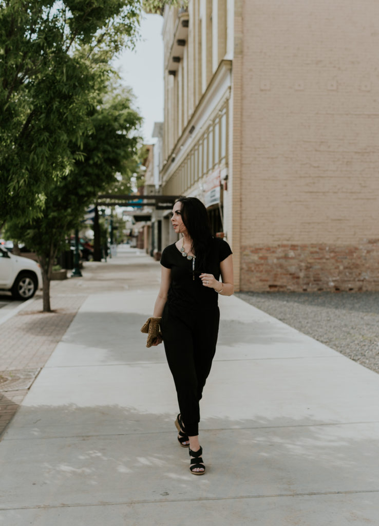 Modest fashion blogger Modest Goddess styles a modest black jumpsuit, locally made in Utah, from shop Carissa Miss.