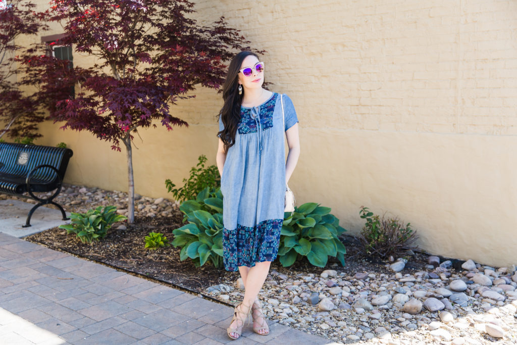 Modest fashion influencer Modest Goddess styles a modest chambray dress.