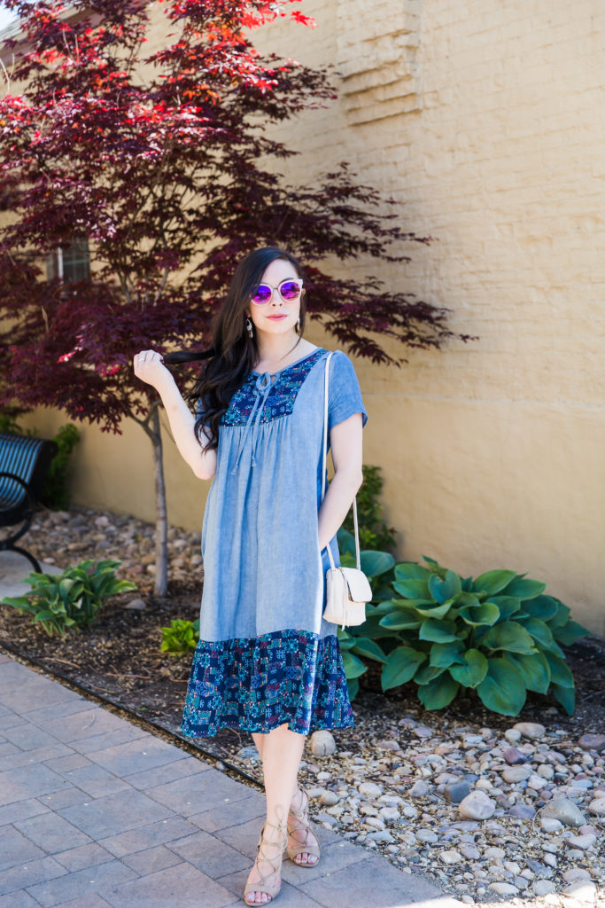 Modest fashion influencer Modest Goddess styles a modest chambray sundress.