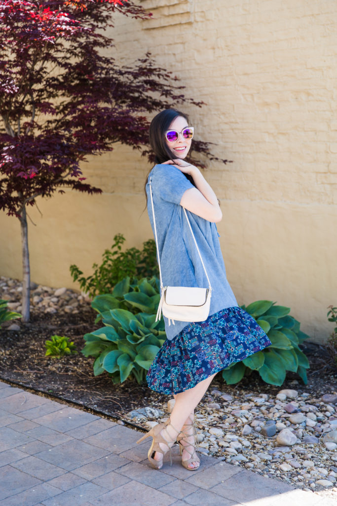 Modest fashion influencer Modest Goddess styles a modest chambray dress perfect for hot summer days.