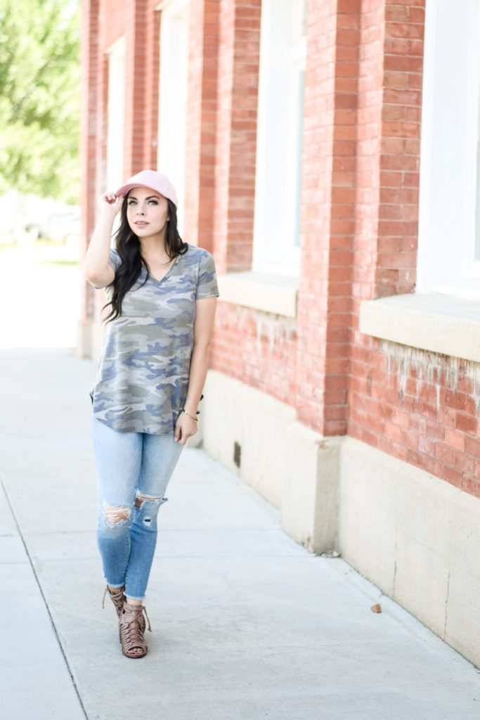 Modest fashion blogger Modest Goddess styles a modest camo shirt and baseball cap, patriotic style.