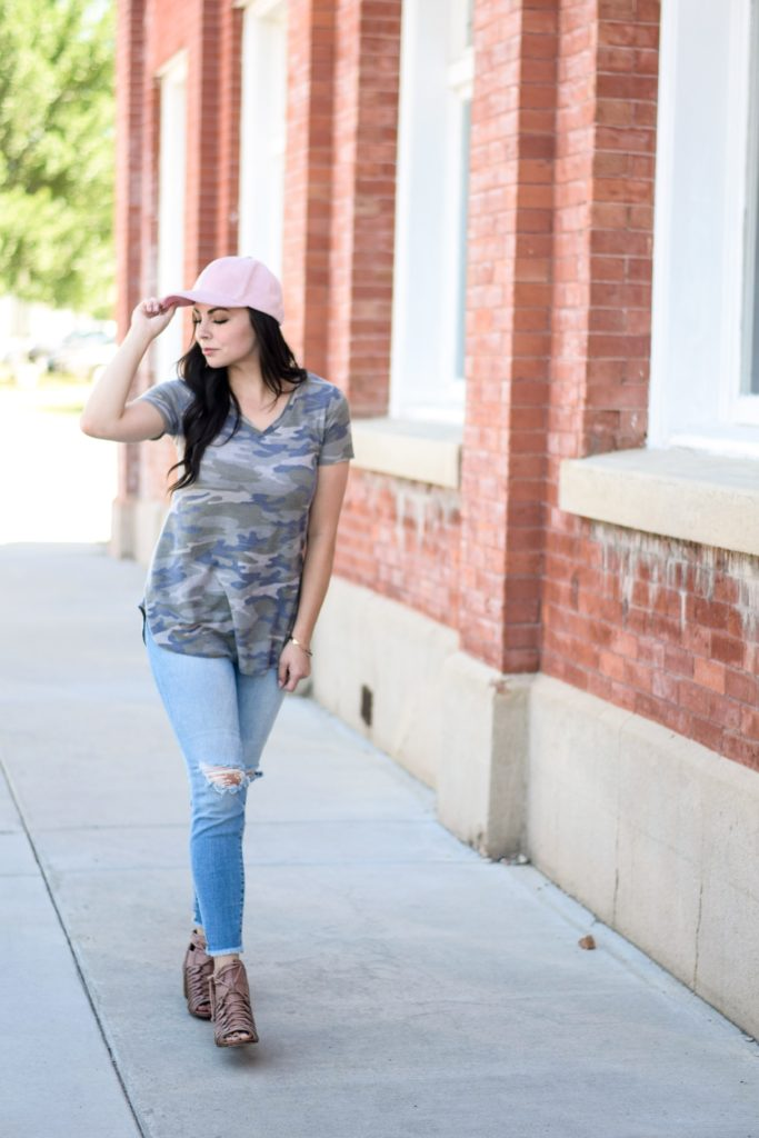 Modest fashion blogger Modest Goddess styles a modest camo shirt and pink suede baseball cap, as a modest patriotic style.