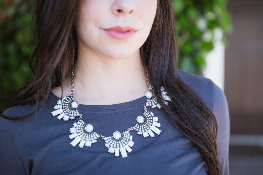 Modest fashion blogger Modest Goddess styles a statement necklace with a modest top.