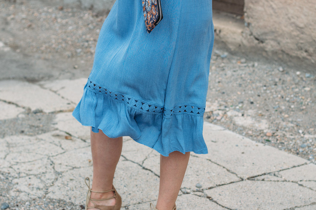 Light blue modest peplum dress hemline details.